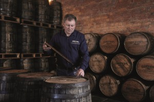 Distillery Image_Interior_ Andy with barrels (Large)
