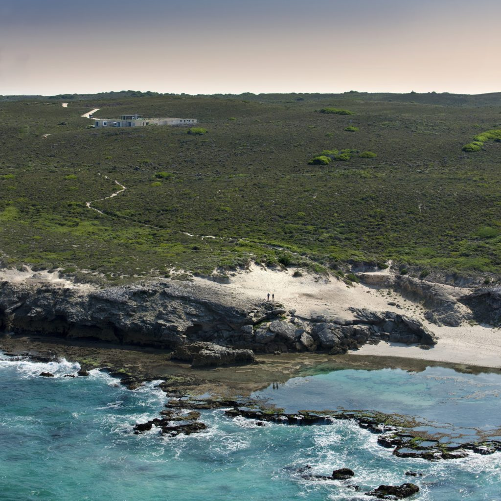 A Rockpool With Morukuru Beach Lodge In The Backgrounds